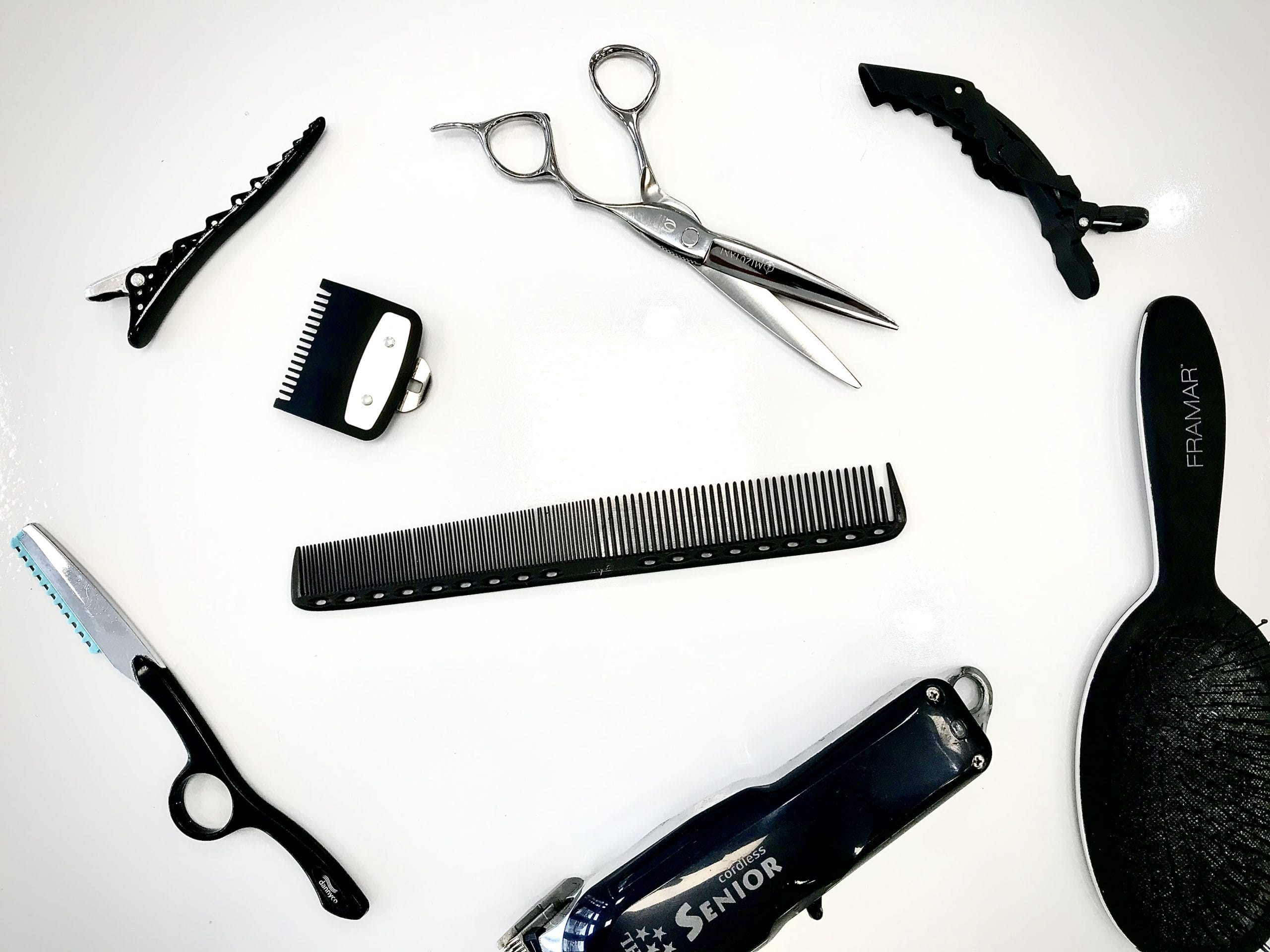 Hair styling tools laid out on table