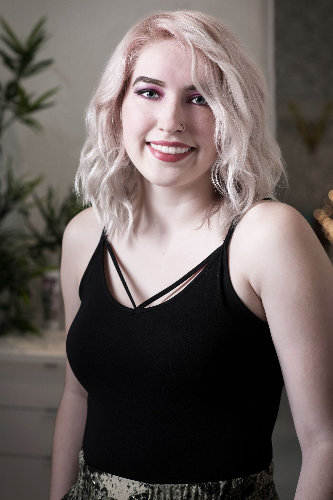 Headshot of Becca, hair stylist at Vivid Hair Studio.