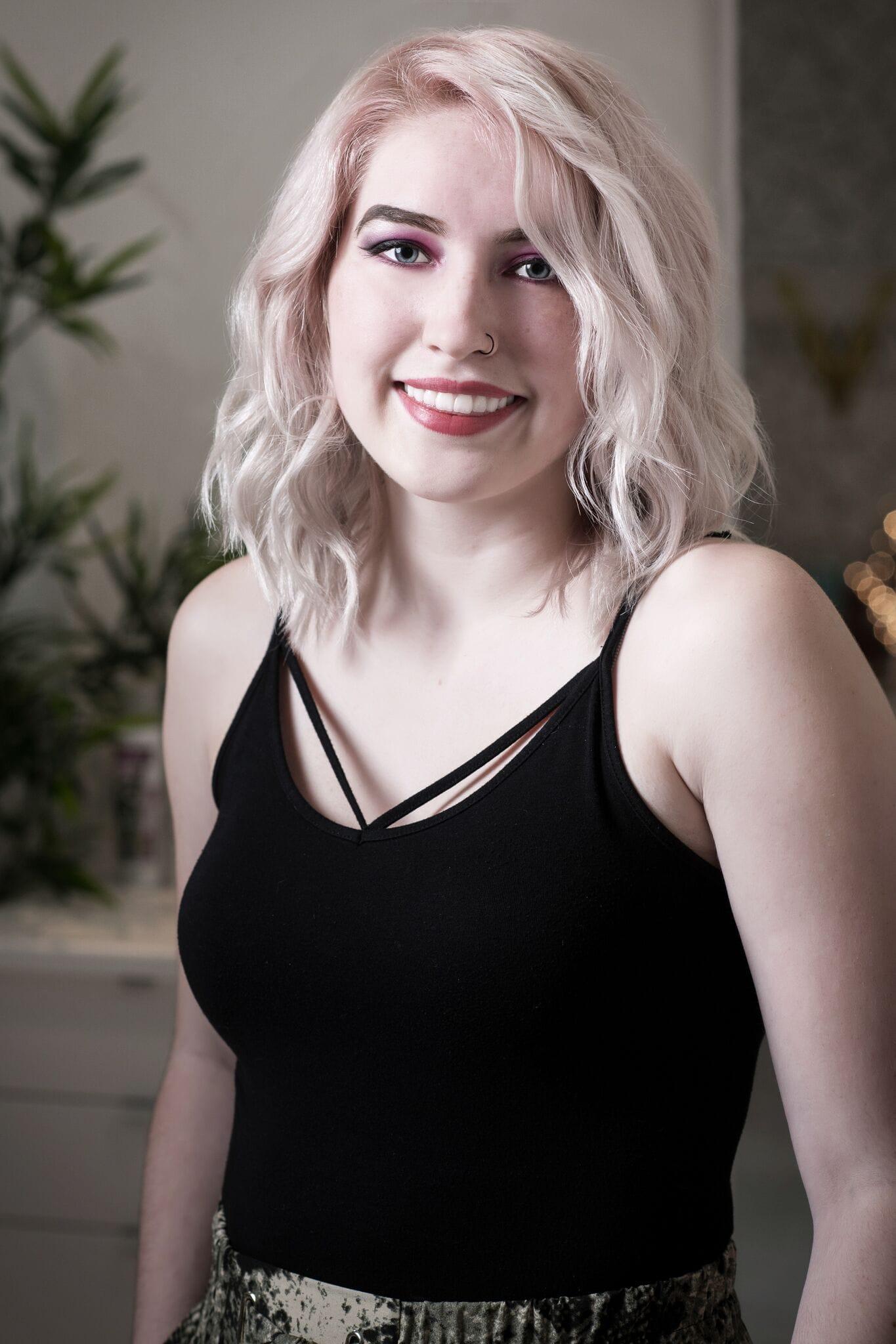 Headshot of Becca, hair stylist at Vivid Hair Studio.
